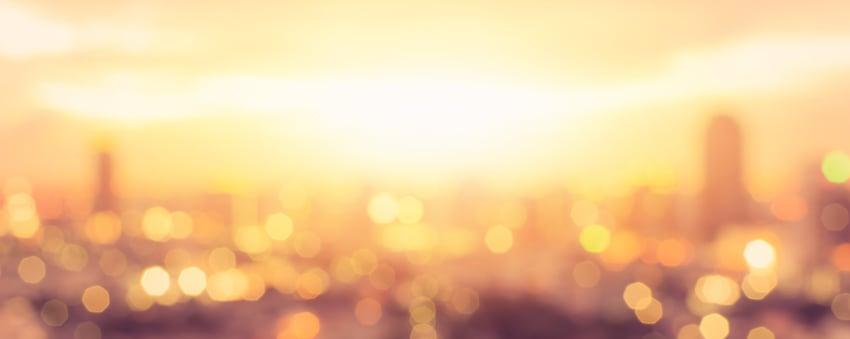 Summer sun blur golden hour sky sunset with city rooftop view