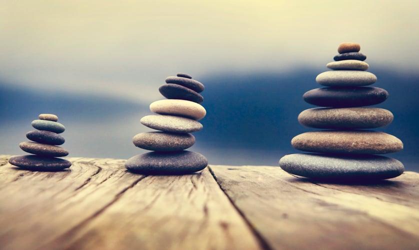 Zen Balancing Pebbles Next to a Misty Lake Concept