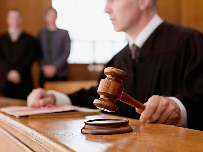 Fiduciaries and 403(b) Judge holding gavel in courtroom