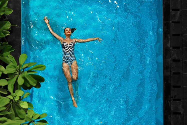 Women swimming on vacation after a investment refresh