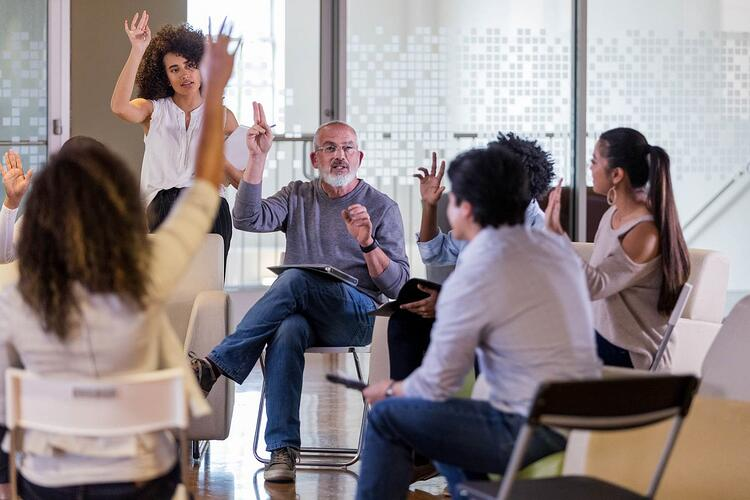 Plan Committee in a meeting