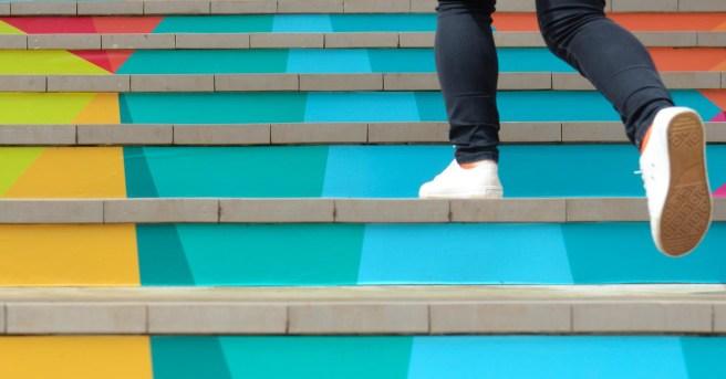 Woman · stairs going upward