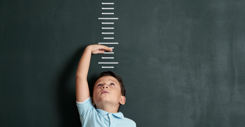 Child measuring himself