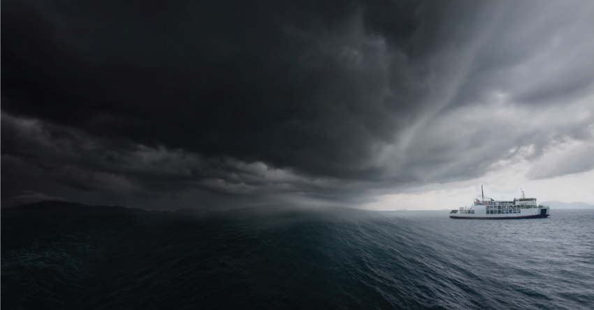 A boat on the sea approaching a storm
