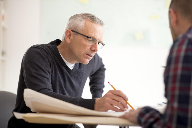 An advisor going over plan eligibility