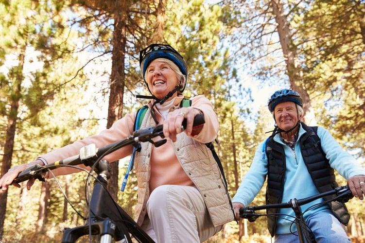 A retired couple enjoying a bike ride