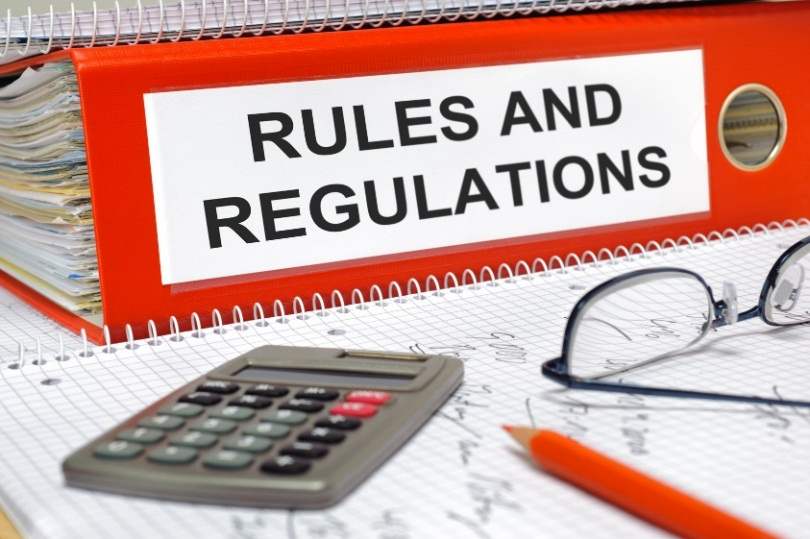 a red binder of a 60-day rollover rules and regulations