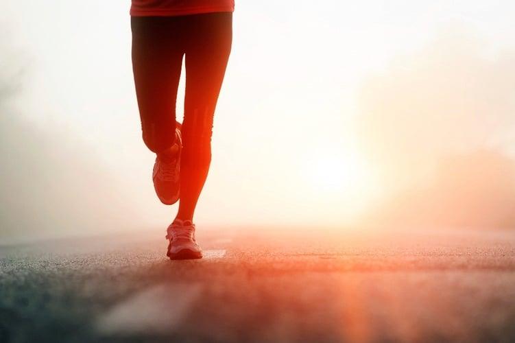 Runner sprinting towards financial wellness