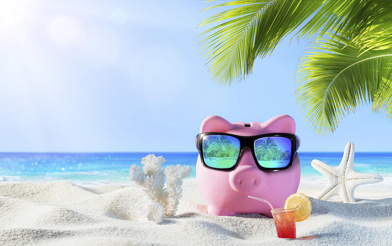 Fiduciary and Retirement Plan Piggy Bank with Drink on the Palm Beach