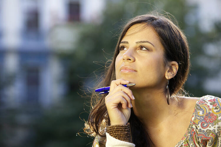 Woman thinking about investment options