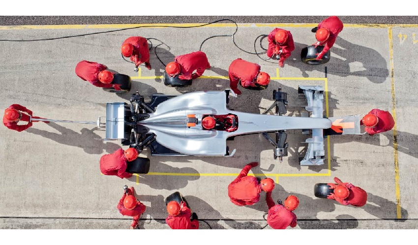 Open wheel racer pitting depicting how collective investment trusts been the vehicle for fast growth