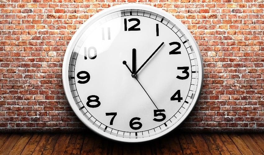 A Clock on a brick wall